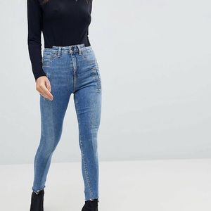 High waisted jeans w/ deconstructed styling